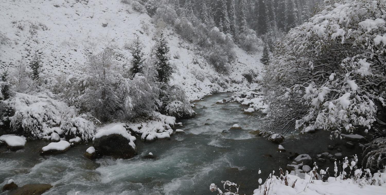 Stream, snowy banks.