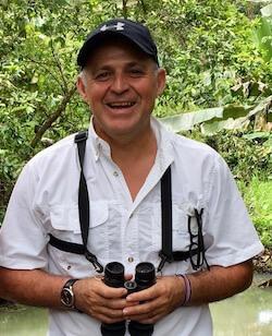 Carlos Manuel Rodriguez with binoculars