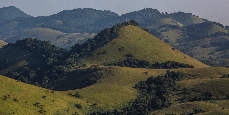Landscape of rolling, green hills.