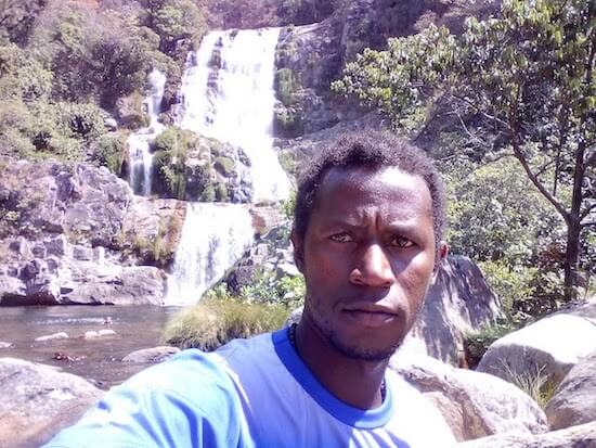 Damiao selfie in front of waterfall.