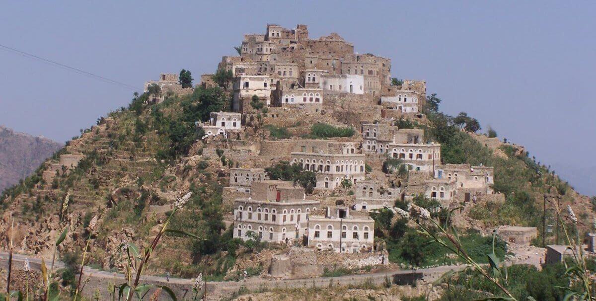 Houses built along hillside.