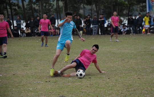 Action shot of two players going for the ball.