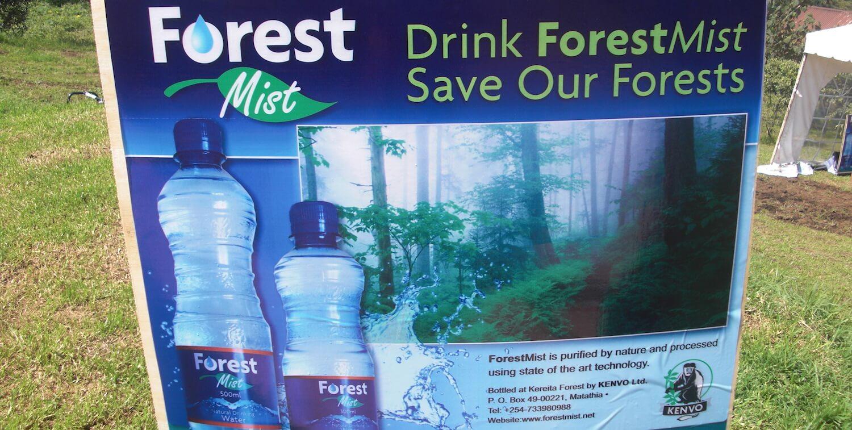 Sign advertising Forest Mist bottled water.