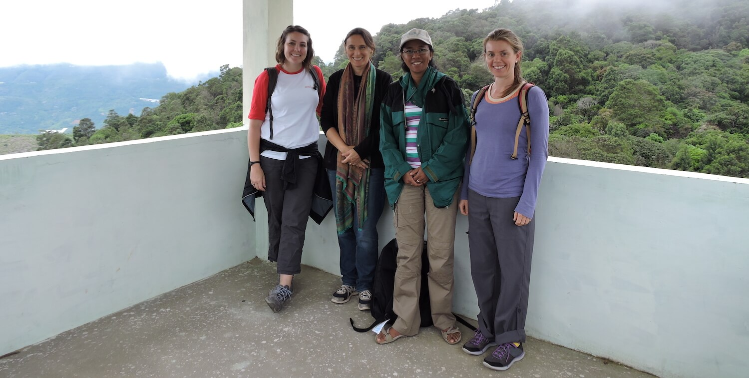 Mandy standing with three other women in an open air building, smiling