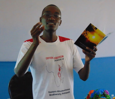 Man with CEPF Eastern Afromontane T-shirt speaking.
