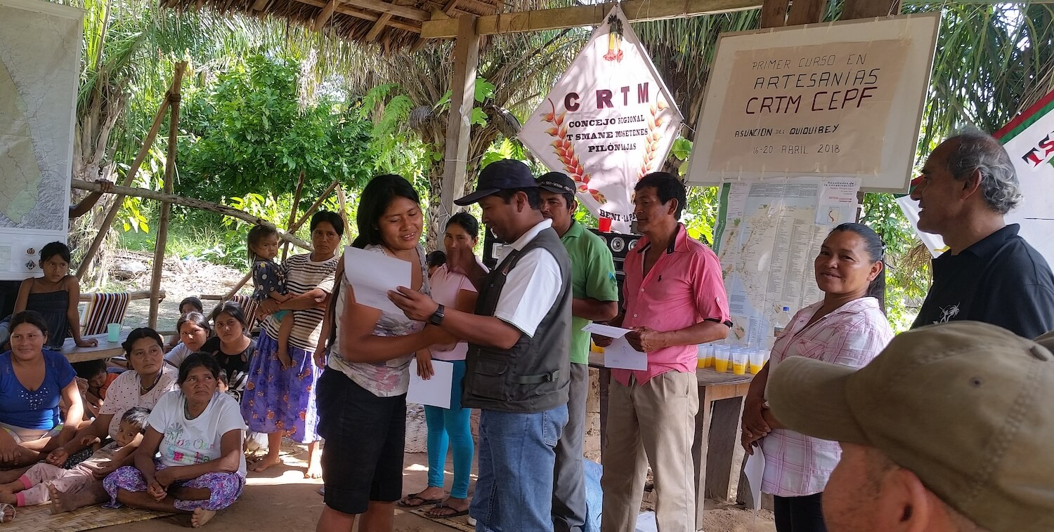 Woman receives certificate from man.