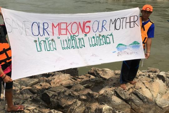 "Two boys, about 12-years-old, hold banner with message ""Our Mekong, Our Mother"""