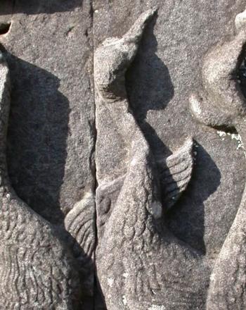 Three sarus cranes depicted on frieze.