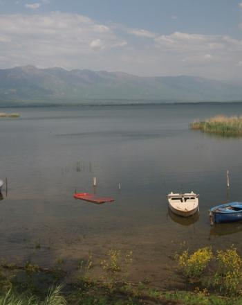 Lake with 3 small boats.