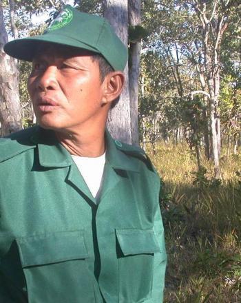 Ranger in green looking over shoulder.