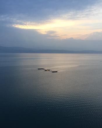 Lake Kivu at sunset under a tranquil sky
