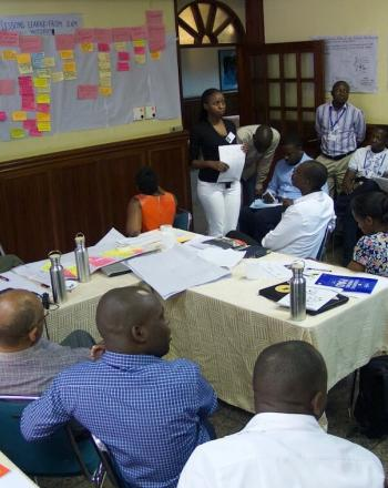 Group of people in meeting.