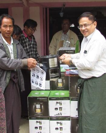 Handing out boxes containing energy-efficient stoves.