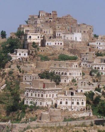 Houses built along hillside.