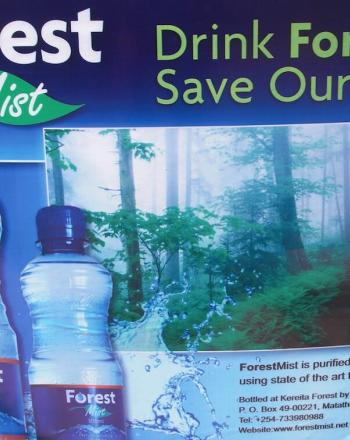 Sign advertising Forest Mist bottled water.