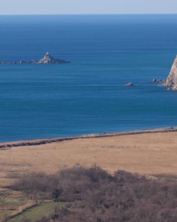 Coastline, a couple small islands in the distance.