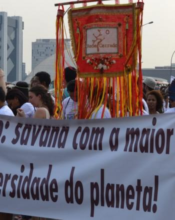 Group marching with banner