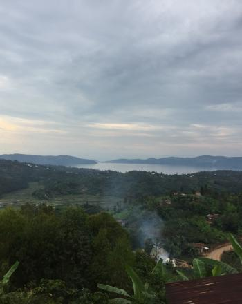 View of Lake Kivu in the distance over wooded hills