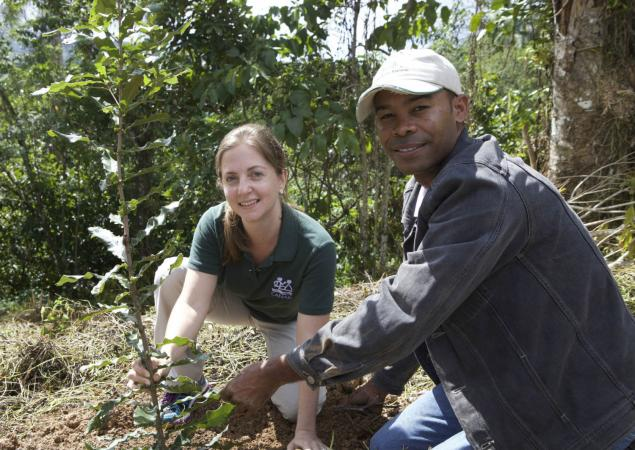 A woman and a man plant a sapling in the Dominican Republic, part of the Caribbean Islands Biodiversity Hotspot.