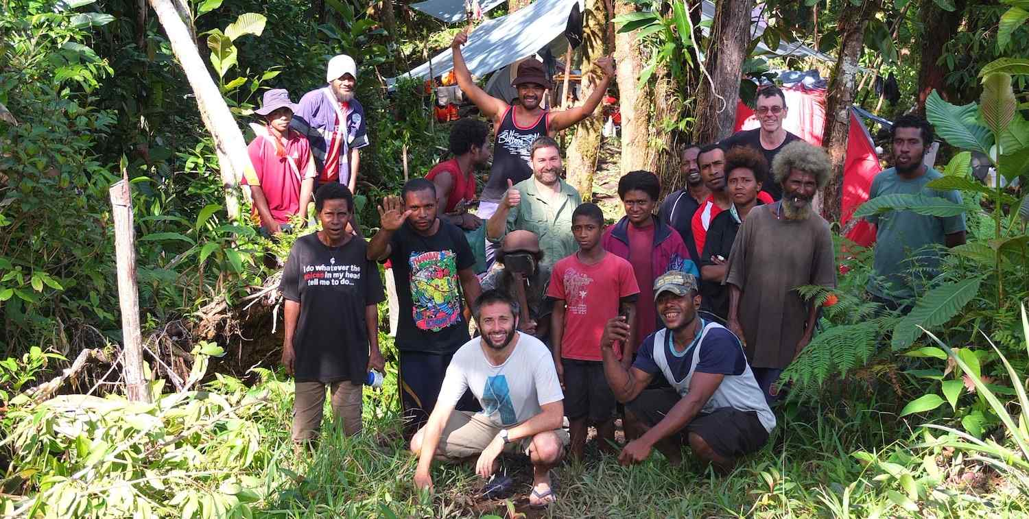 Group of men pose in a heavily vegetated area on Manus Island, Papua New Guinea.