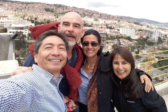 The 4 members of the Tropical Andes RIT, city in the background